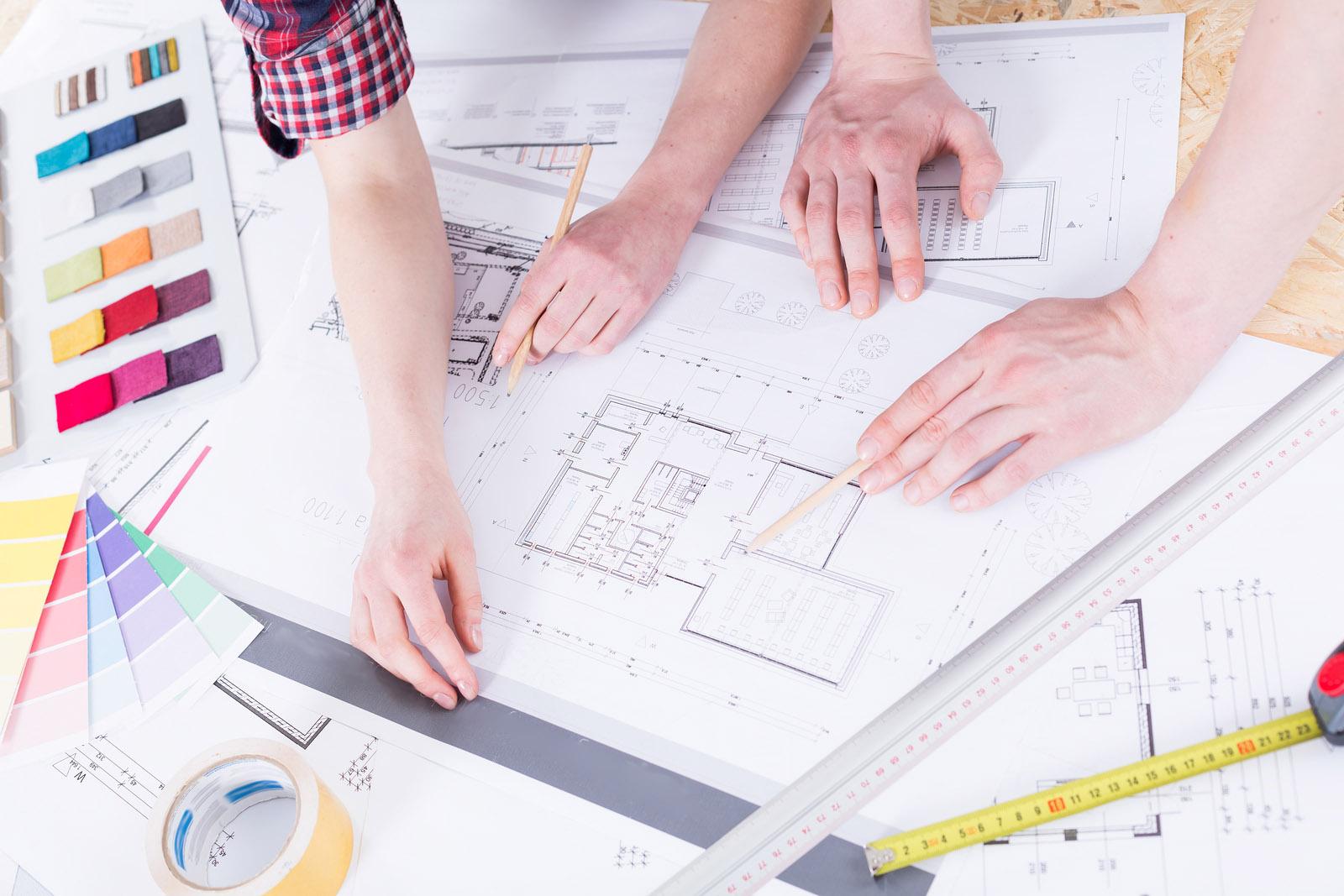 Floor plan designers deciding on final details for new custom home plans