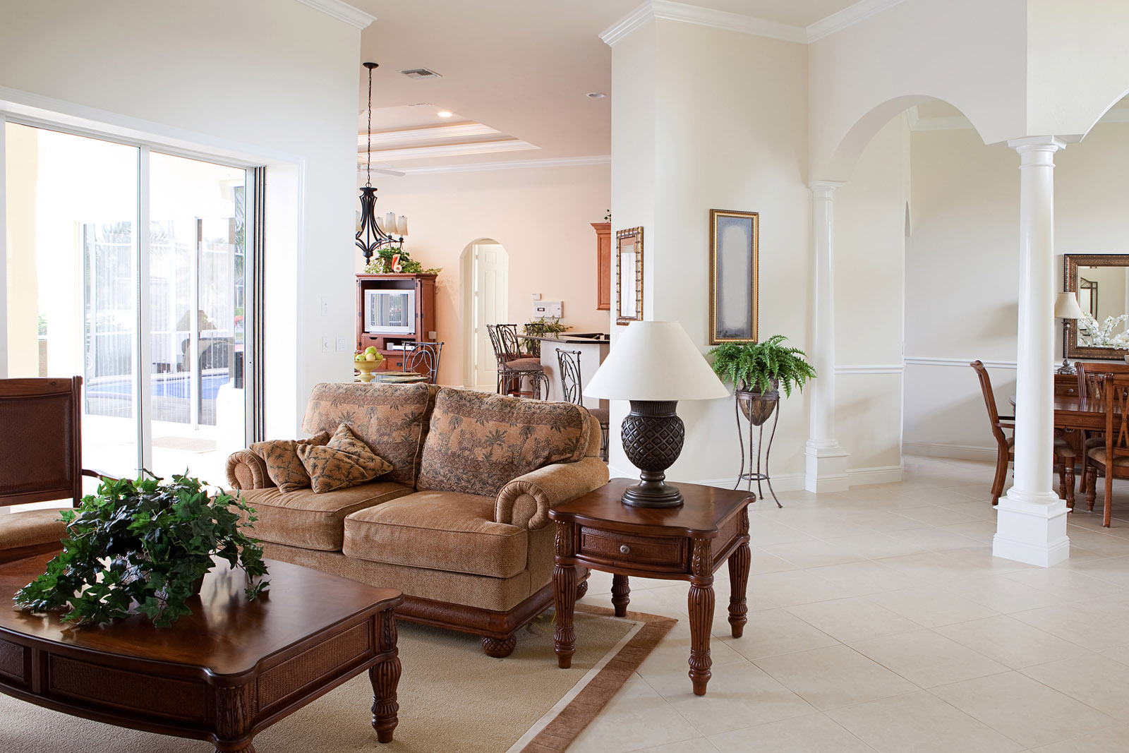 Renovated living room with tiled floors and arched entryways