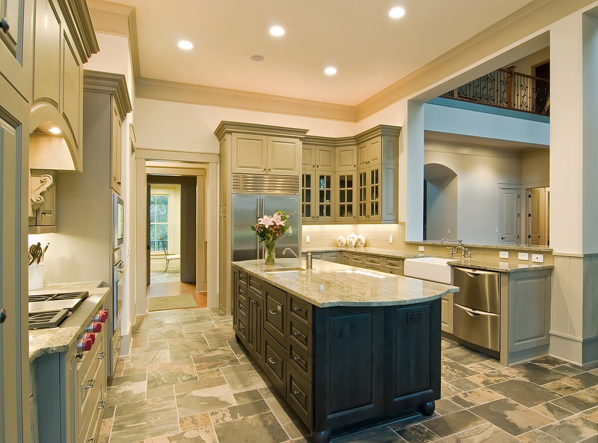 Home kitchen remodel with stainless steel appliances, cabinet lighting and granite countertops