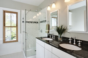 Completed bathroom renovation and glass shower enclosure