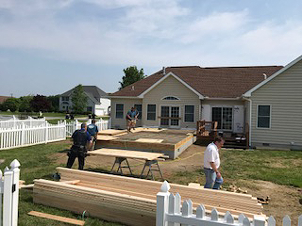 Home builders from H&H Builders, Inc. construct a home addition
