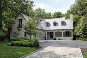 Newly built custom home with large driveway and wooded backyard