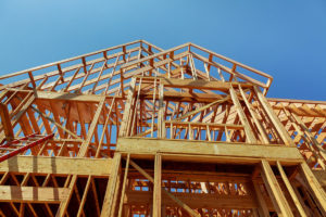 Home builders finish framing a two-story custom home