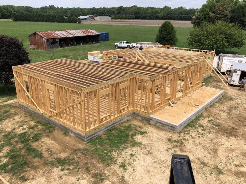 Home builders at H&H begin framing new custom house