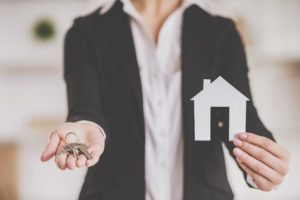 Realtor handing over keys to new homeowners
